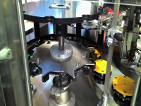 Multi-format inlet and outlet star wheels, adaptable to cylindrical bottles with variable diameters ranging from 60 mm to 110 mm
